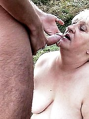 Grey haired plumper Anna Mary opening up her phat thighs to cram her slit with a rock hard dong