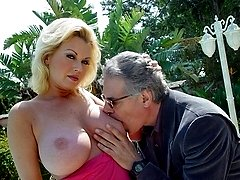 Big tit granny Carolyn has her huge tits suckled by the pool in road daylight