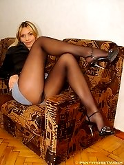 Sweet babe showing her legs in pantyhose