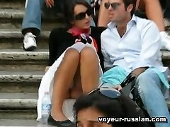 Lovely tourist chick inhot white mini-skirt displays panties in a Russian park