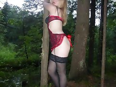 Slutty bitch spreads pussy in the woods