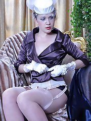 Classy hottie changes her negligee for sheer panties and gartered stockings
