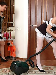 Salacious French maids in fine stockings going for 69ing right on the floor