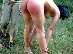 Teen bitch gets her ass spanked on green grass