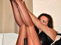 Strapon Jane slips in to a passionate pair of nylon stocking and a bit of leather to go with her enormous black strap-on,  before her virgins come over for a fuck
