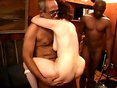 Two old sluts eating cock