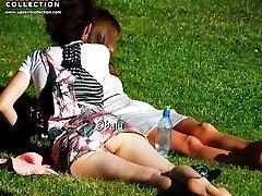 Upskirting and sunbathing in park