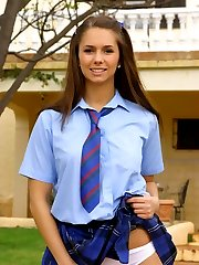 Cheeky brunette Louise in college uniform and stockings
