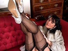 Raven is wearing some fab full fashion nylons and a super black girdle!