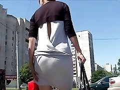 Girl in shorts seduces with hot ass