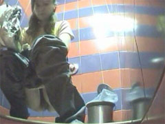 Two babes pissing in a spycammed beach toilet