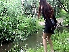 Hot amateur babe in short skirt in the forest