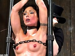 Welcome back flexible gymnast Wenona. What is not to like about this fit slut? She is flexible, tough, and loves to cum. Up for the challenge, she endures very strict bondage, pain and pleasure.In scene one, Wenona is custom fitted to a made to measure frame in a legs behind the head/open pile driver position. Perfect for pussy flogging, Claire gets her mound nice and hot pink. She also introduces a cruel nipple to labia predicament with clamps and twine so Wenona cannot fully relax into the stretch. Once satisfied, Claire attaches the pulley and fully inverts Wenona. Going after her ass only, she is finger banged and vibrated until the cunt can't cum any more.Scene two, Wenona is bound in a kneeling offering pose. So submissive with her ass trapped up in the air. Perfect for the cattle prod. Her ass gets a nice thick steel hook in it that is also bound to her hair. After the cattle prod comes the cane and the single tail. Claire wants to make sure Wenona has her full attention. Now, for the cunt. Finally Claire slides her thick hand into Wenona's willing cunt. Pummeling her. Writhing in pleasure, Wenona has no choice but to cum all over Claire's hand and the vibrator.Finally, Wenona endures one of the most challenging suspensions Claire can think of - a chain only straddle split suspension. Chain is cold, uncomfortable, and like the rigid restraints - not forgiving. Spread wide open, her nipples get tied to her toes, the cane comes out, and finally the sybian. With a sybian finish, cum hungry and insatiable Wenona gets to do nothing but be overwhelmed by pleasure as Claire chokes her from behind with leather around her neck. Watch her muscles intensely contract an the sweat pour down her body as it can't help but have orgasm after orgasm.
