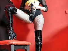 Femdom Strapon Jane plays with her xxl strapon cock clad in fishnets, boots and yellow corset