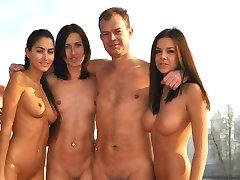 Sexy naughty nudist chicks posing outdoors