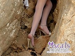 Naked teenage angel posing on the rocks in only her sexy white nylons