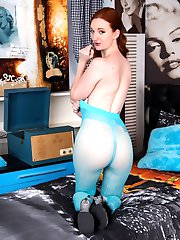 Sexy redhead Zara is in some stunning turquoise designer hose with a see through gusset!