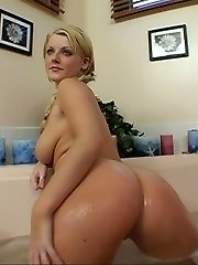 Big breasted blonde with even bigger booty gets down on dick