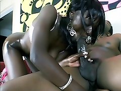 Stunning black pornstar Raw Chocolate gets lubricated up and ready for a dose of cock stuffing