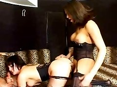 Whore in stockings getting double teamed by busty tranny and guy