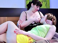 Sex-starved mature BBW wakes up a sexy girl for sensual lesbian lovemaking