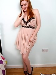 Curvy red head Kloe Kane slowly strips out of her fancy sundress showing off her perfect perky udders and taut pink cooch