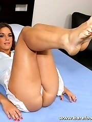 Brunette cutie licks her own painted toes before taking a load on her feet