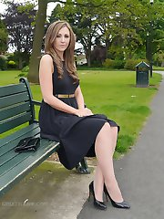 Sexy brunette Debbie takes a stroll into the park in a pretty dress and gorgeous matching black high heel stilettos