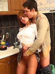 Cutie getting her pussy massaged through hose before scoring in the kitchen