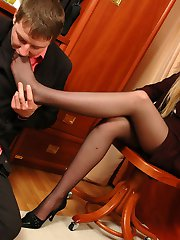 Luscious secretary in smooth hose knowing how to service cock with her feet