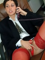 secretary in red panties flashes her knickers at her desk