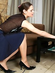 Sizzling hot chick meticulously examining her expensive control top tights