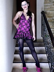 Smashing looking brunette in a lacy dress and expensive fashion stockings