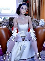 Lovely bride in a long wedding dress and expensive white nylons gets nasty