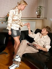 Pantyhosed babe teasing guy with her upskirt look before going down on him