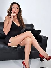 Nylon Jane dressed in lingerie and silky nylons strings up her high heel shoes and smokes in her fetish