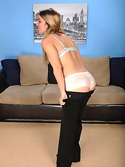 Gorgeous MILF Penelope McDowd spreads her pussy.