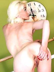 Older blonde babe Janotova spreads her pussy lips.