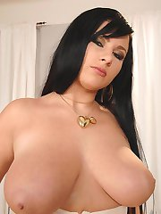 New busty babe Martina strips