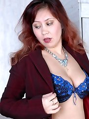 Lusty mature dame and her youthful female co-worker frolicking strap-on games