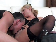 Dolled-up mommy makes her pussy well-prepped for a rock-hard shaft of a suspended stud