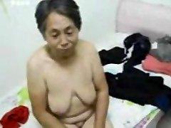 Japanese Grandma get dressed after sex