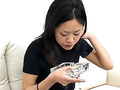 Pretty Asian smoking and salivating