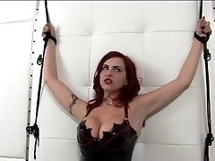 Hot red-haired in leather and perky tits gets ducked by dildo