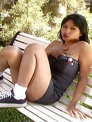 Sexy young Asian pornographic star Mika Suntan gets naughty on a bench