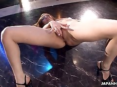 Asian stripper getting kinky on the pole as she strokes