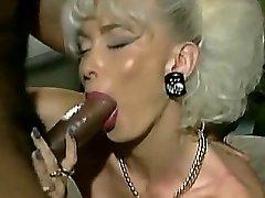 Vintage Busty platinum blond with 2 Big Black Cock facial cumshot
