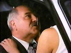 Elder Man With Hooker In Van