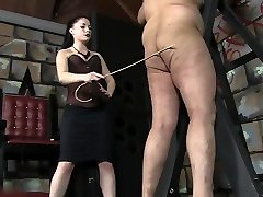 Sexy Mistress caning masculine slave