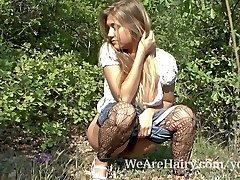 Hairy doll Riana S likes her walk outside